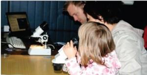 Visitors enjoying the microscopes